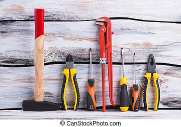 Set of construction tools on wooden background.