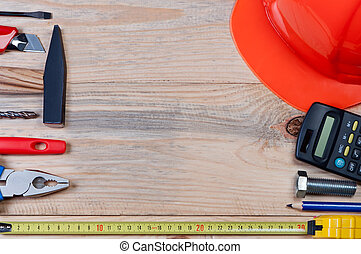 Set of construction tools on wooden board.