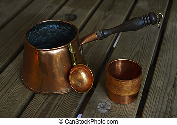 set of copper cookware coffee on wooden table