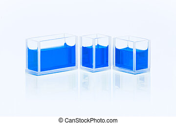 Set of cuvettes with blue liquid