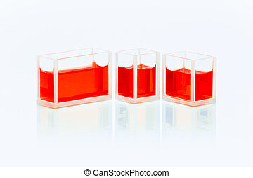 Set of cuvettes with red liquid
