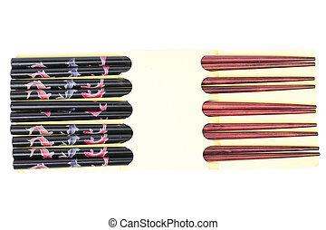Set of dark wood chopsticks on white