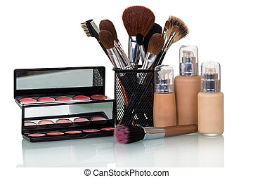 Set of decorative cosmetics for makeup, brushes in stand, isolated on white