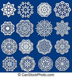 Set of Decorative paper snowflakes. White on blue background