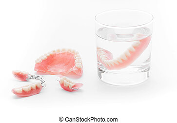 Set of Denture in glass of water on white background
