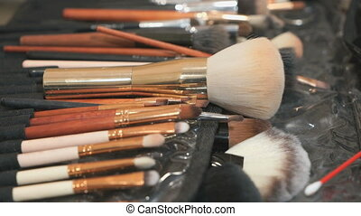 Set of different brushes for make-up on the table