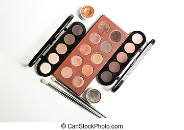 Set of different eyeshadow palettes and makeup brushes