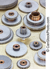 set of different gear cogwheel details on scratched background