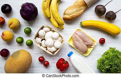 Set of different organic food on white wooden table, top view. Cooking food background. Health food concept.