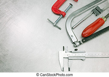 Set of different tools on metal background