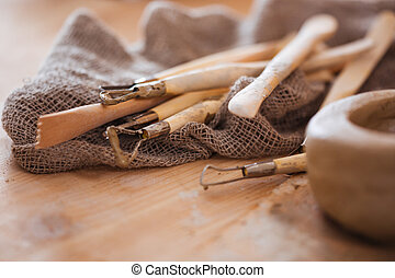 Set of dirty craft sculpting tools in pottery workshop - Set...