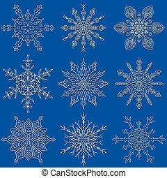 Set of drawn snowflake silhouettes