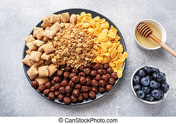 Set of dry cereal flakes for Breakfast with milk and berries. Healthy natural food.