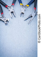 Set of electric metal nippers on scratched metallic background c