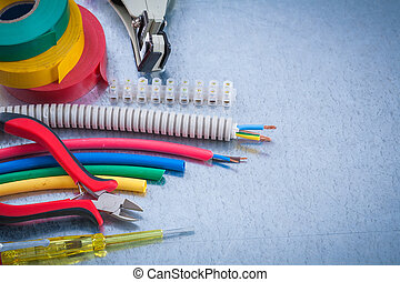 Set of electrician?s tools on scratched metallic surface construction concept.
