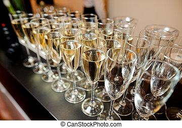 Set of elegant glasses filled with champagne