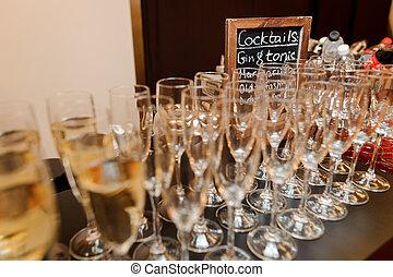 Set of elegant glasses filled with tasty champagne