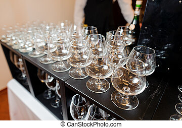Set of empty and elegant wine glasses on the table
