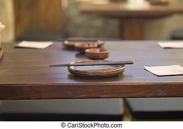 Set of empty dish on table in asian restaurant.