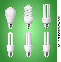 Set of energy saving light bulbs on green background