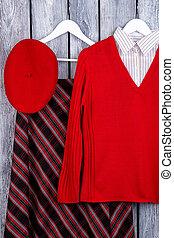 Set of feminine clothes, wooden background.