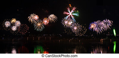 Set of fireworks with reflection in river