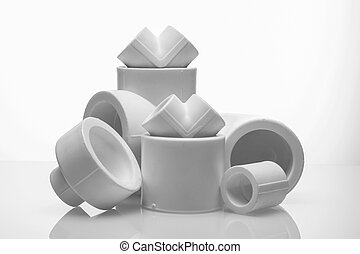 set of fittings for pvc pipes on white background