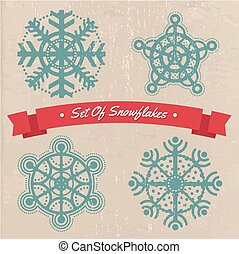 Set of flat snowflakes on the old paper