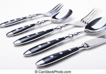 Set of flatware on white background