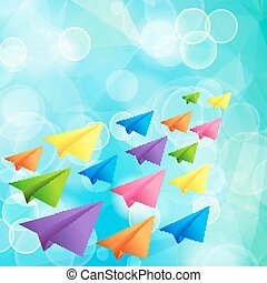 Set of flying color paper planes on the blue blurred background
