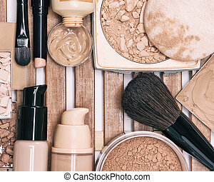 Set of foundation makeup products with professional brushes...
