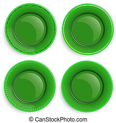 Set of four empty plates with a different design.