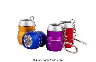 Set of four metal LED flashlight keychain isolated on white...