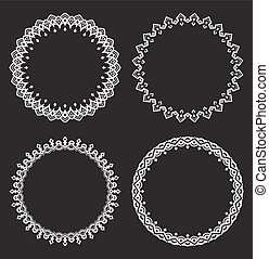 Set of four white round frames on a black background.
