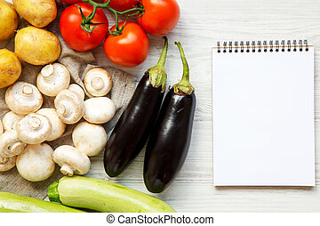Set of fresh raw veggies for cooking healthy vegetable food on a white wooden background, top view. Healthy eating concept. Overhead, flat lay.