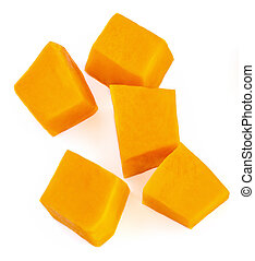 Set of fresh sliced pumpkin isolated on white background. Pumpkin cubes. Top view. Flat lay