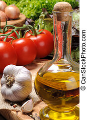 Set of fresh vegetables with olive oil on the wooden cutting...
