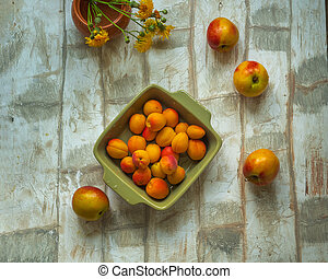 Set of fruit nectarine and apricot on a light table, shot from the top angle