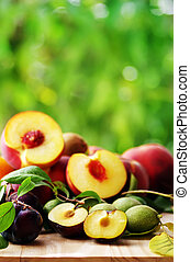 Set of fruits on green background