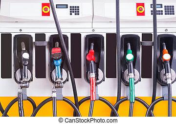 nozzles - Set of fuel pump nozzles at the Gas service...