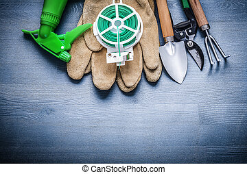 set of garden tools on painted wooden board