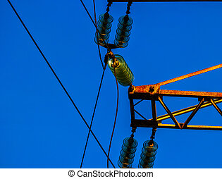 Set of Glass Electric insulators mounted on rusty power tower