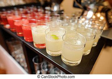 Set of glassed filled with fresh summer cocktails