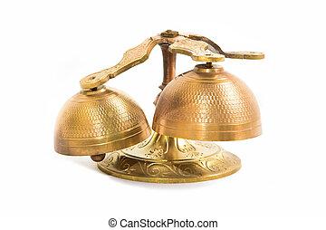 Set of gold handbells on white background