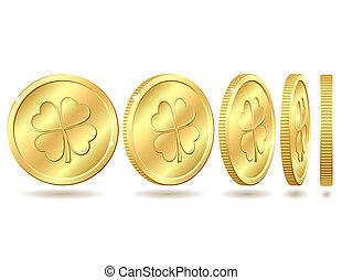 Set of golden coins with four leaf clover.
