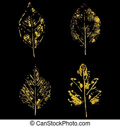 golden leaves on black background