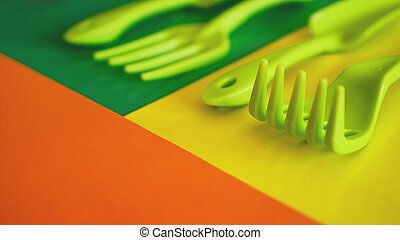 Set of green garden tools on green and yellow background - ...