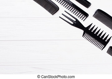 Set of hairdresser combs on white background.