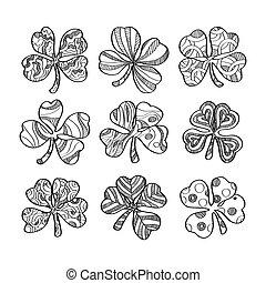 Set of hand drawn monochrome shamrock isolated on white background.