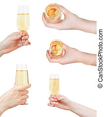 set of hand holding glass with sparkling wine